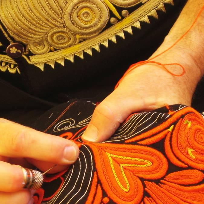 Embroidering a Bigouden costume © E Cléret